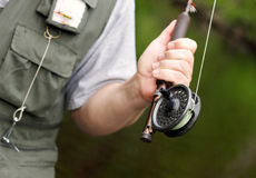 Canne à pêche et bobine de mouche Photos libres de droits