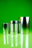 Canned. Assorted tins isolated against a green background Royalty Free Stock Image