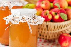Canned Apple Juice and Apples in Basket Stock Images