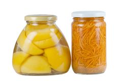 Canned apricots and carrots Royalty Free Stock Photos