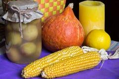 Canned apricots, pumpkin, corn, lemon, candle, eco fruits vegetables Stock Photos