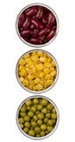 Canned beans, peas and maize in metal cans Royalty Free Stock Images