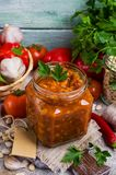 Canned beans with vegetables. In tomato sauce on wooden background. Selective focus Royalty Free Stock Photography