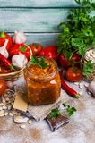 Canned beans with vegetables. In tomato sauce on wooden background. Selective focus Stock Photography