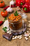 Canned beans with vegetables. In tomato sauce on wooden background. Selective focus Royalty Free Stock Photo