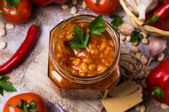 Canned beans with vegetables. In tomato sauce on wooden background. Selective focus Stock Images