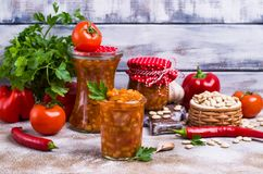 Canned beans with vegetables. In tomato sauce on wooden background. Selective focus Royalty Free Stock Images