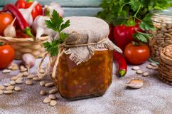 Canned beans with vegetables. In tomato sauce on wooden background. Selective focus Stock Image
