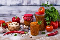 Canned beans with vegetables. In tomato sauce on wooden background. Selective focus Stock Photo
