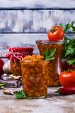 Canned beans with vegetables. In tomato sauce on wooden background. Selective focus Royalty Free Stock Photos