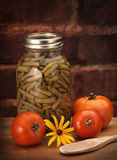 Canned beans on wood counter Stock Images