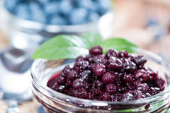 Canned Blueberries. Portion of canned Blueberries with some fresh fruits Stock Image