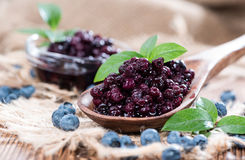 Canned Blueberries. Portion of canned Blueberries with some fresh fruits Royalty Free Stock Image
