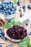 Canned Blueberries. Portion of canned Blueberries with some fresh fruits Stock Photos
