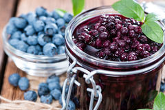 Canned Blueberries. Portion of canned Blueberries with some fresh fruits Stock Images
