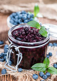 Canned Blueberries. Portion of canned Blueberries with some fresh fruits Stock Photography