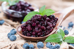Canned Blueberries. Portion of canned Blueberries with some fresh fruits Stock Photo