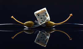 Canned capers and Blue cheese Stock Photography