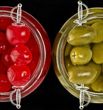 Canned cherries and olives Stock Photo