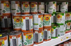 Canned concentrated tomato sauce for sale at Israeli food supermarket. ASHDOD, ISRAEL - MAY 23, 2017: canned concentrated tomato sauce for sale at Israeli food stock photos