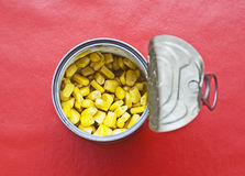 Canned corn. Top view of can full of delicious corn Royalty Free Stock Photography