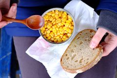 Canned corn and bread Royalty Free Stock Photo