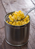 Canned Corn with Fork Royalty Free Stock Photos