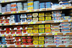 Canned fish. FRANCE - JULY 2014  Shelves filled with tin cans of fish in a Leclerc supermarket Stock Photos
