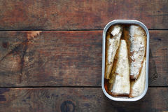 Canned Fish On Wood Stock Photo