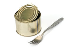 Canned food and fork. It is isolated on a white background Royalty Free Stock Photos