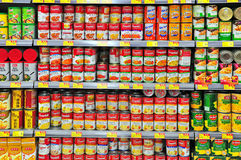 Canned food at hong kong supermarket. Assortment of canned food on shelves at a supermarket in hong kong Royalty Free Stock Image