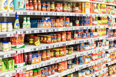 Canned Food And Special Sauces For Sale On Supermarket Stand Stock Photography