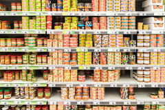 Canned Food On Supermarket Stand Royalty Free Stock Photos