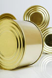 Canned food in tin cans. Canned food in tins on a light background Stock Image
