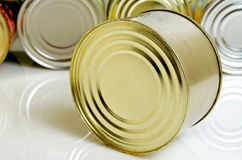 Canned food in tin cans. Canned food in tins on a light background Stock Photography