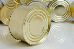 Canned food in tin cans. Canned food in tins on a light background Royalty Free Stock Photography