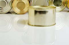 Canned food in tin cans. Canned food in tins on a light background Royalty Free Stock Photos