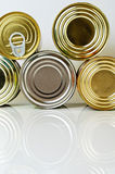 Canned food in tin cans. Canned food in tins on a light background Stock Photo