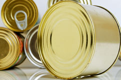 Canned food in tin cans. Canned food in tins on a light background Stock Photos