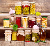 Canned food. On wooden background royalty free stock photo