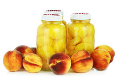 Canned and Fresh Peaches Stock Photography