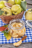 Canned and fresh quince. Canned fresh and healthy quince on an old wooden table Royalty Free Stock Images