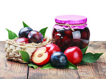 Canned fruit compote and fresh plums Stock Photos