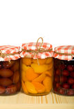 Canned fruits on the shelf - isolated Stock Photo