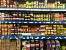 Canned goods. On shelves in the supermarket Royalty Free Stock Photos