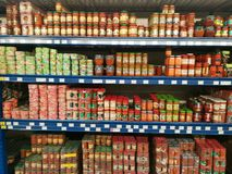 Canned goods. On shelves in the supermarket Royalty Free Stock Images