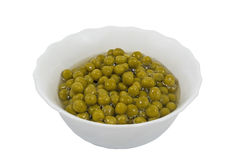 Canned green peas in glass chalice Royalty Free Stock Photo