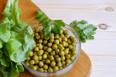 Canned green peas, lettuce leaf Stock Photos