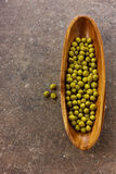 Canned green peas in wooden bowl Royalty Free Stock Photography