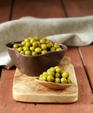 Canned green peas in a wooden spoon Stock Photography